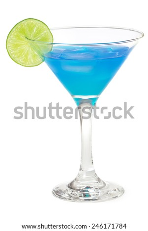 blue cocktail in martini glass garnished with lime - stock photo