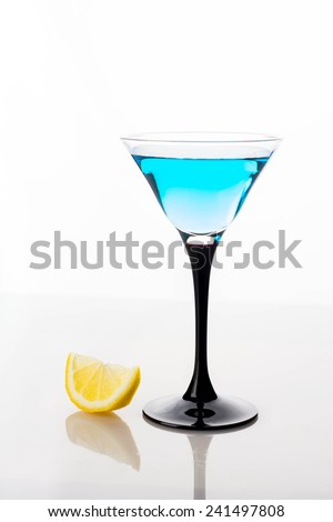 Blue cocktail isolated on white - stock photo