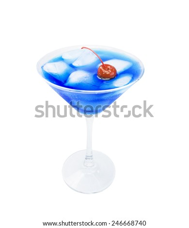 blue cocktail, red cherry, ice, glass, curacao - party background - stock photo