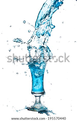 blue cocktail splashing from glass on white background. - stock photo