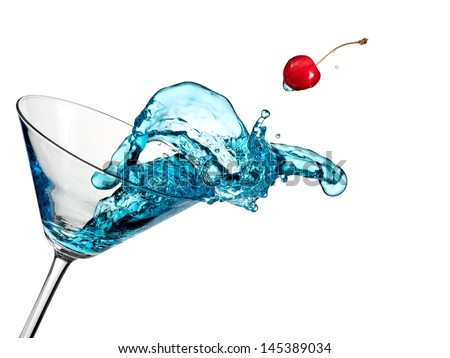 Blue cocktail up from a martini glass - stock photo