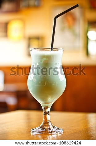 Blue cocktail with espresso, brandy, curacao, milk