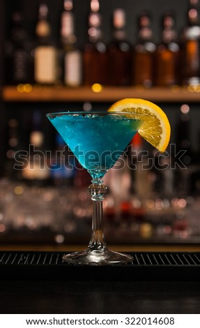 Blue cocktail with ice - stock photo