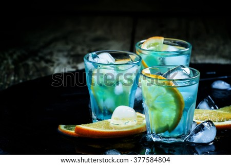Blue lagoon cocktail stock images royalty free images for Orange and blue cocktails