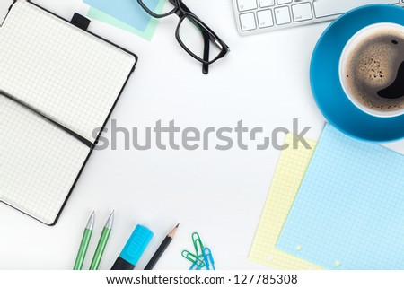 Blue coffee cup and office supplies. View from above. Closeup on white background - stock photo