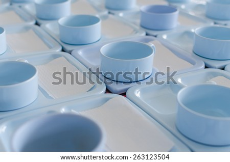 Blue coffee cups on tray