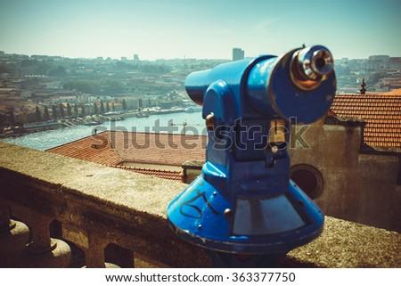 Blue coin operated telescope in Porto. - stock photo