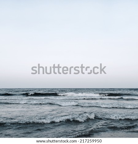 Blue cold sea water and sky background - stock photo