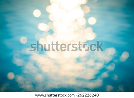 Blue color blurry of bokeh background on morning time at the swimming pool - stock photo