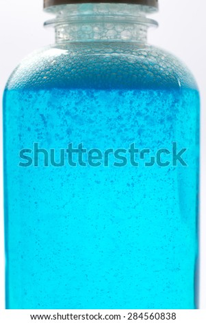 Blue color chemical isolate in white background.