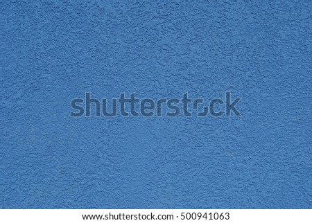 Blue color plastered wall background/ texture.