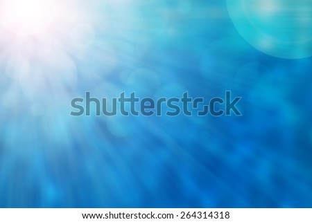 Blue Color with light rays and blurred background - stock photo