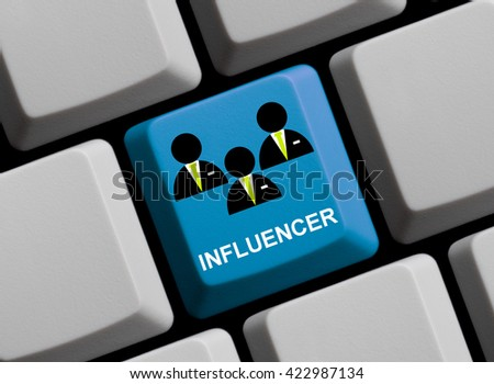 Blue computer keyboard is showing Influencer - stock photo