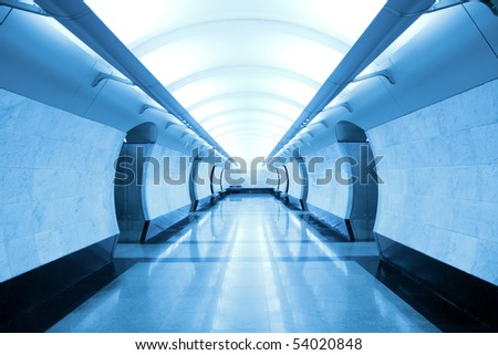 blue corridor inside marble metro station - stock photo