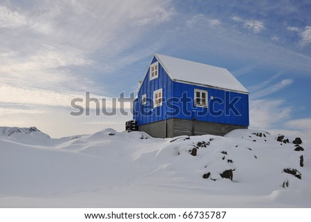 Blue Cottage in the Kulusuk village, Greenland - stock photo