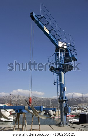 Blue crane for lifting boats in marina