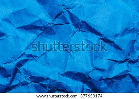 Blue crumpled paper background. - stock photo