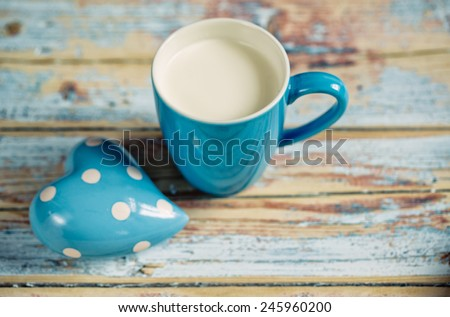Blue Cup filled with fresh warm Milk - stock photo