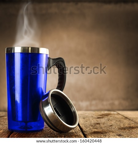 blue cup of hot drink  - stock photo