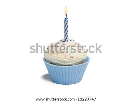Blue cupcake with candle on white background