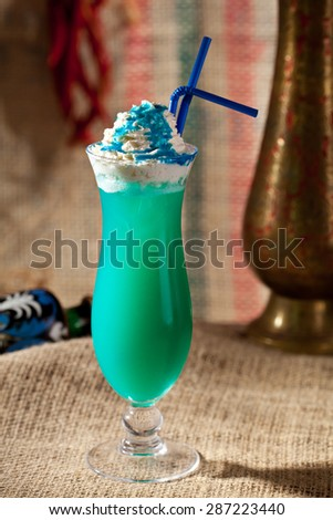 Blue Curacao Alcohol Cocktail with White Cream - stock photo