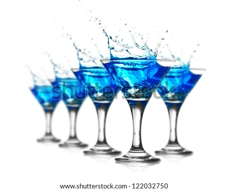 Blue curacao cocktail with splash - stock photo