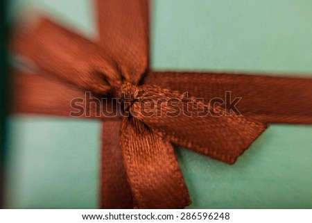 blue cute box with brown ribbon - gift for holiday guests - stock photo