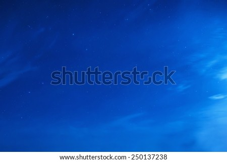 Blue dark night sky with many stars. Milky way on the space background - stock photo