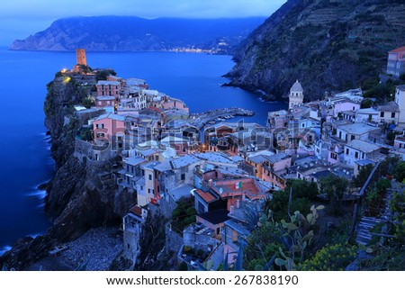 Blue dawn view with nautical twilight of Vernazza on cliff, an amazing village of Cinque Terre, Italy - stock photo
