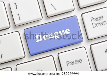 Blue dengue key on keyboard - stock photo