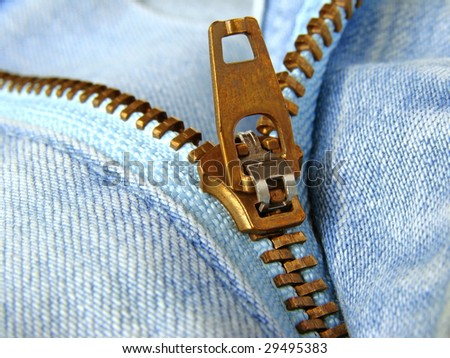 blue denim clothes fragment with zipper - stock photo