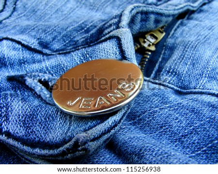 blue denim clothing fragment with button closeup - stock photo