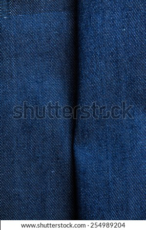 Blue Denim Jean Fabric / Concept and Idea of Denim Industry, Sewing and Fashion, Vintage Rustic Style. Vertical for Pattern, Background, Wallpaper and Textured. - stock photo