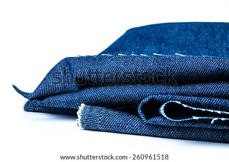 Blue Denim Jean Fabric, Prepare Cut and Fold to use isolated on white. / Concept and Idea of Denim Industry, Sewing and Fashion, Vintage Rustic Style. Pattern, Background, Wallpaper and Textured. - stock photo
