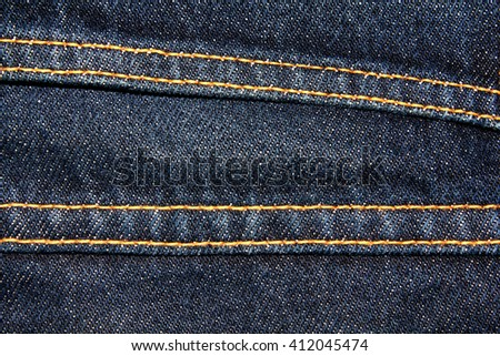 Blue denim jeans texture background with seams,close up,select focus with shallow depth of field - stock photo