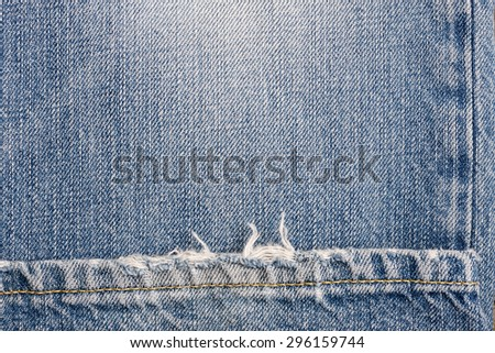 Blue denim jeans texture with space for text. - stock photo
