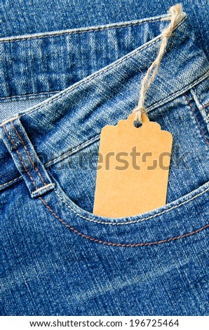 blue denim jeans with paper label - stock photo