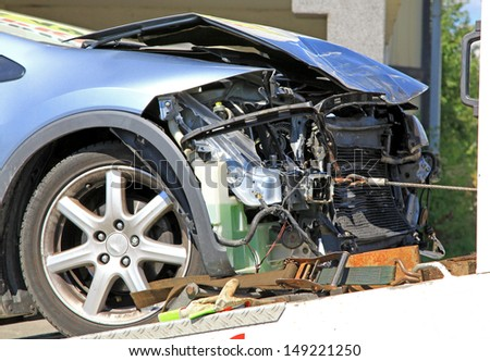 Blue destroyed car after car crash - stock photo