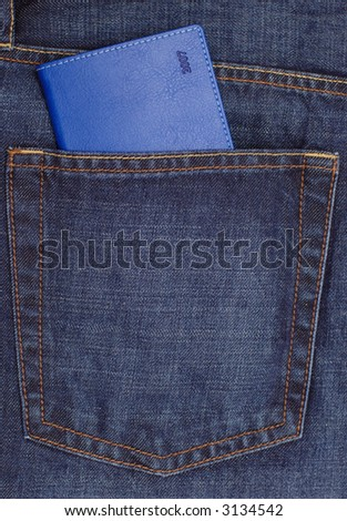 Blue diary for year 2007 in jeans pocket - stock photo