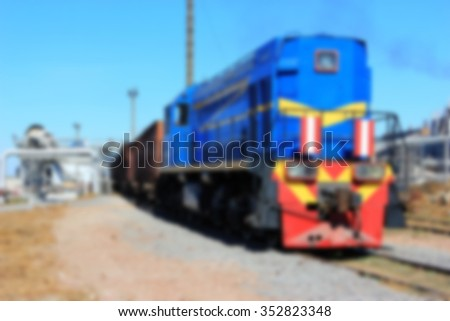 Blue Diesel Locomotive On unloading sugar beet factory for the production of sugar, blured - stock photo