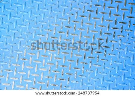 Blue dimond metal surface - stock photo