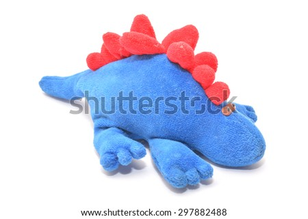 blue dinosaur plush toy  - stock photo