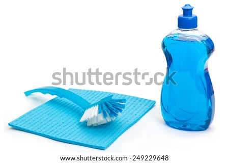 Blue dish washing detergent with brush and cloth on white background
