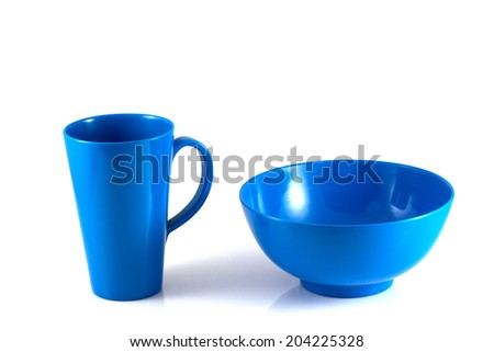 Blue disk and green cup isolate on white background - stock photo