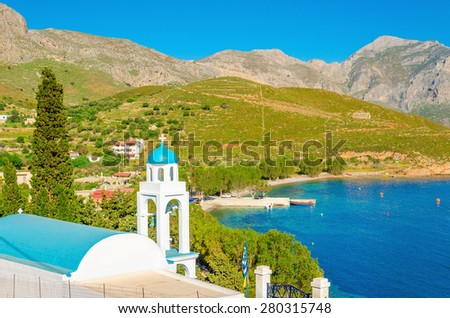 Blue dome of Greek church with sea bay of Greek Islands, Greece - stock photo
