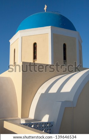 Blue dome of the greek orthodox Agios Georgios church in Oia, Santorini island, Greece.