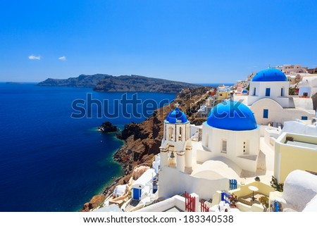 Blue domed churches on the Caldera at Oia on the Greek Island of Santorini. - stock photo