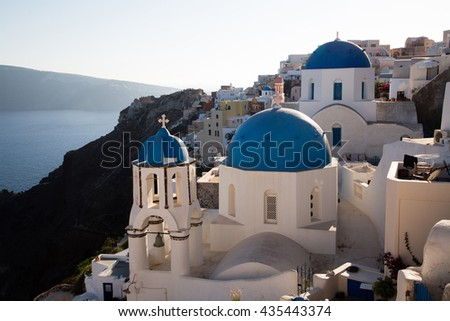 Blue domes and their bell tower in Oia. Santorini