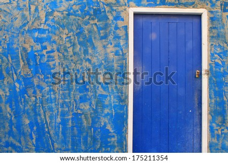 blue door and old wall - stock photo