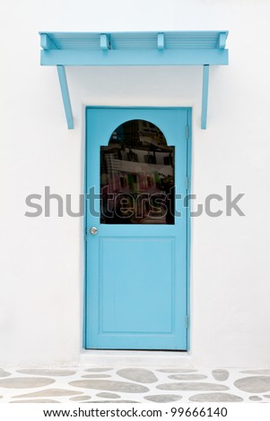 Blue door and sunshade - stock photo